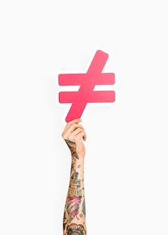 Dłoń trzymająca nierówny symbol