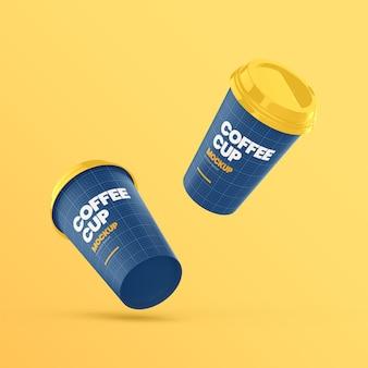 Dwa papierowe kubki do kawy latający makieta