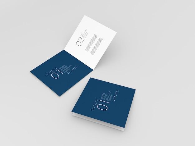 Dwa realistyczne kwadratowe makiety broszury składanej podwójnie