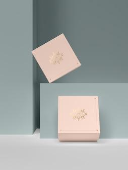 Dwa różowe pudełka z biżuterią ze złotymi symbolami