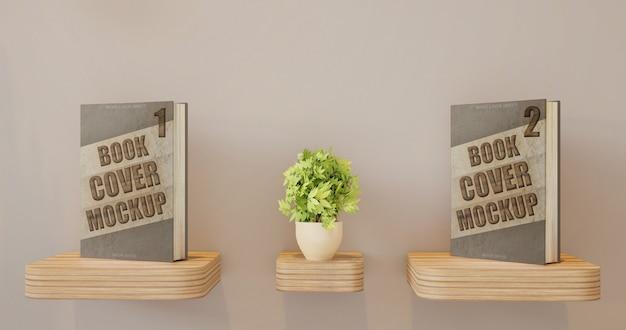 Dwie książki obejmują makietę na biurku na ścianie