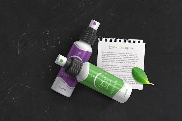 Dwie plastikowe butelki z rozpylaczem z makietą rozdartego arkusza