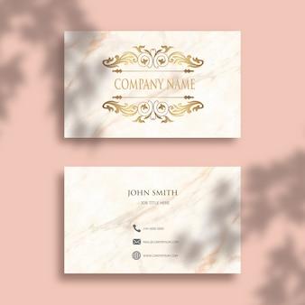 Edytowalna wizytówka z eleganckim złotym wzorem