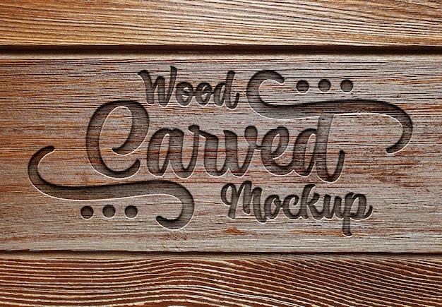 Efekt grawerowanego tekstu na fakturze deski drewnianej makieta