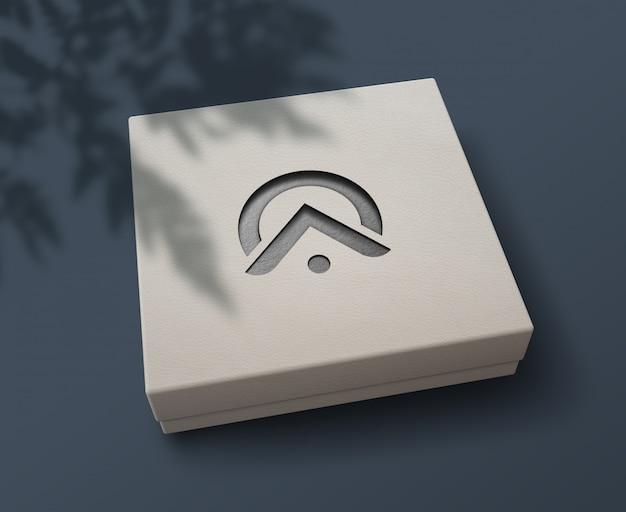 Elegancka makieta logo wycinana laserowo na pudełku