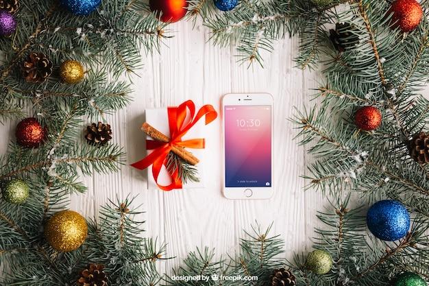 Elegancki smartphone makieta z boże narodzenie projekt