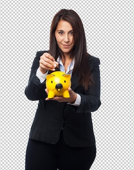 Fajna biznesowa kobieta z piggy-bankiem