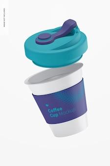 Filiżanka kawy z makieta z pokrywką, spadająca