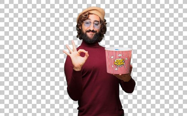 Francuski artysta z beretem trzymającym wiadro popcorns