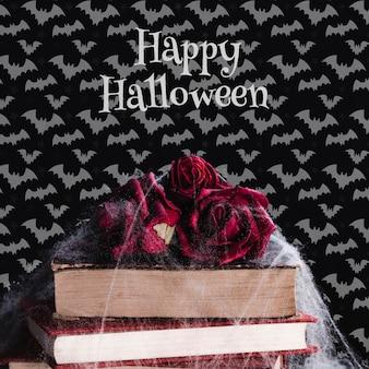 Frontowy widok halloween pojęcie z kwiatami i książkami