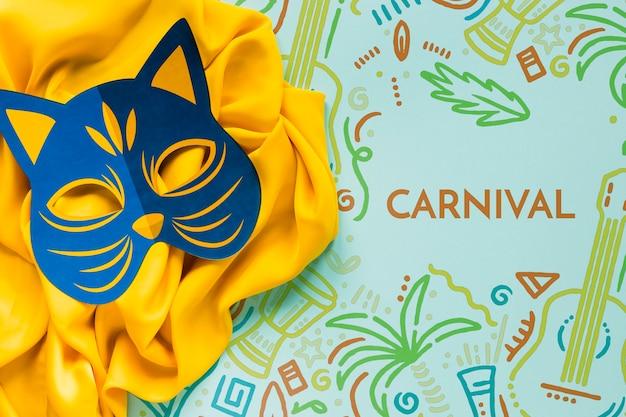 Karnawałowa maska kota na tkaninie