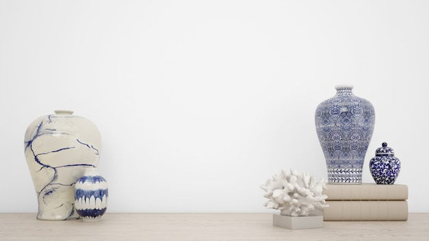 Klasyczne wazony do dekoracji wnętrz i biała ściana z copyspace