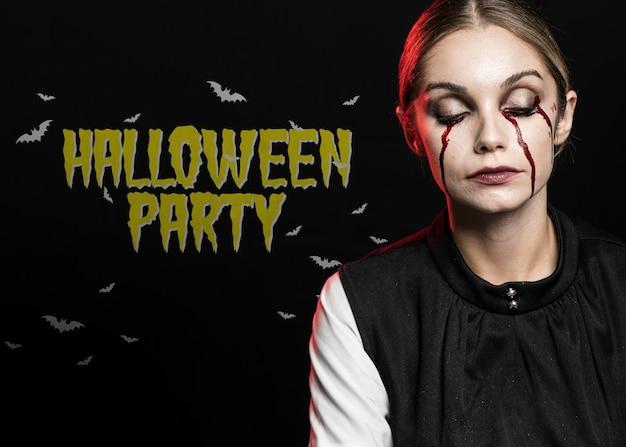Kobieta płacze krwią z oczami zamykającymi makijaż na halloween