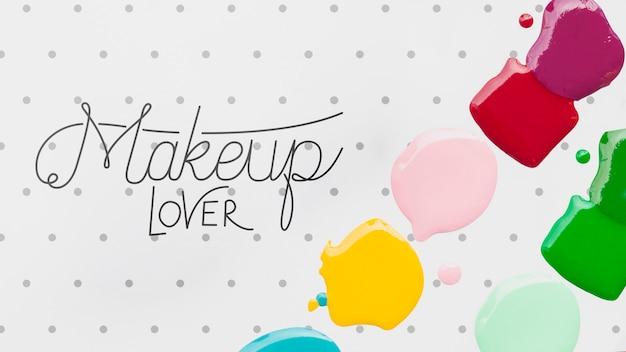Kolorowy lakier do paznokci plamy makiety koncepcji makijażu