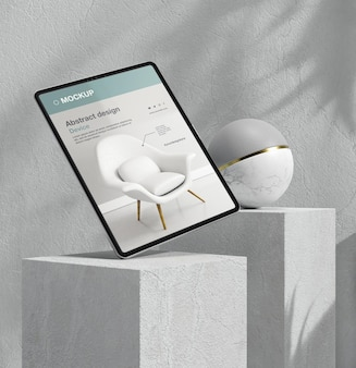 Kompozycja makiety tabletu z elementami kamiennymi i metalowymi