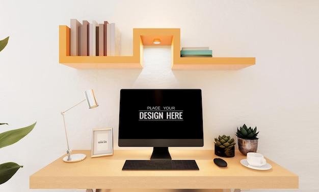 Komputer na stole w makiecie miejsca pracy