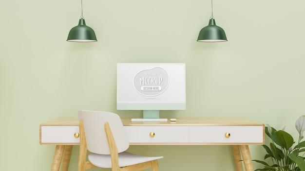 Komputer z ekranem makiety na biurku z lampą krzesła i doniczką w zielonej ścianie pokoju renderowania 3d