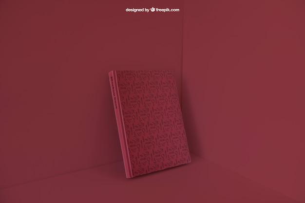 Książka pochylona w rogu z czerwonym kolorem