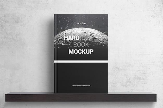 Książka w twardej oprawie na półce makieta