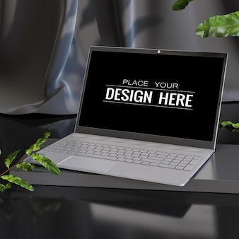 Laptop na biurku w makiecie miejsca pracy