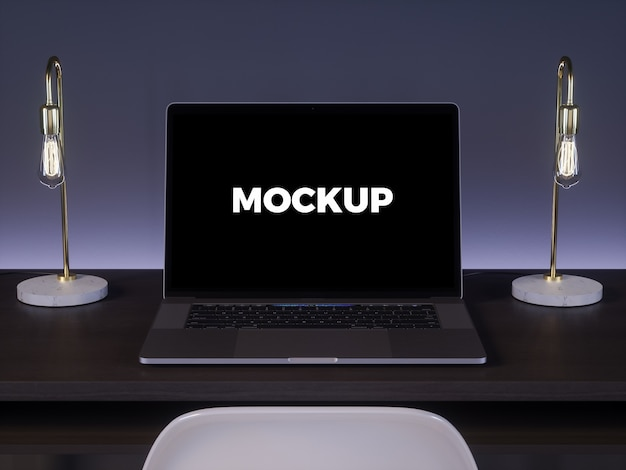 Laptop na ciemnym biurku makieta