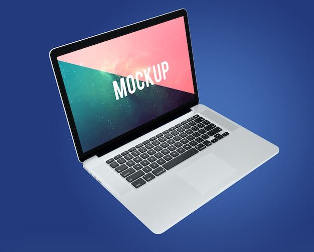 Laptop na niebieskim tle makieta