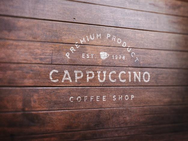 Logo makieta na drewnianym tle