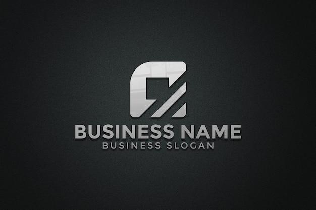 Logo makieta na ścianie czarnej tekstury