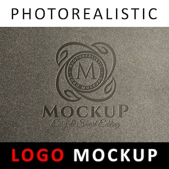 Logo makieta - wybite logo na granulowanej ścianie