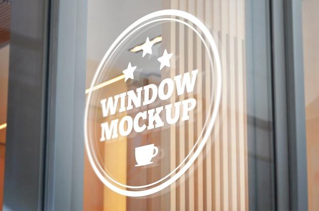 Logo, makieta znak na szklanym oknie