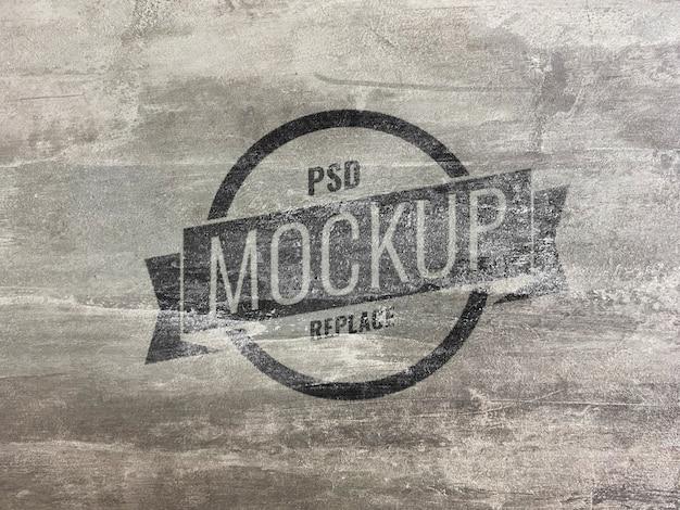 Logo marki makieta na ścianie grunge cementu