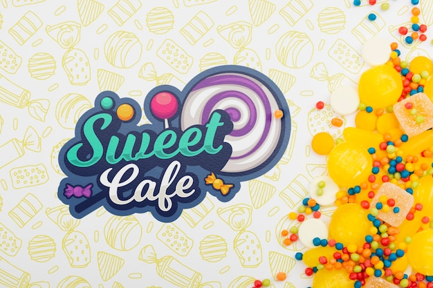 Logo słodkiej kawiarni z żółtymi cukierkami