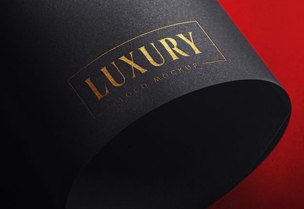Luksusowa makieta logo na czarnym papierze rzemieślniczym