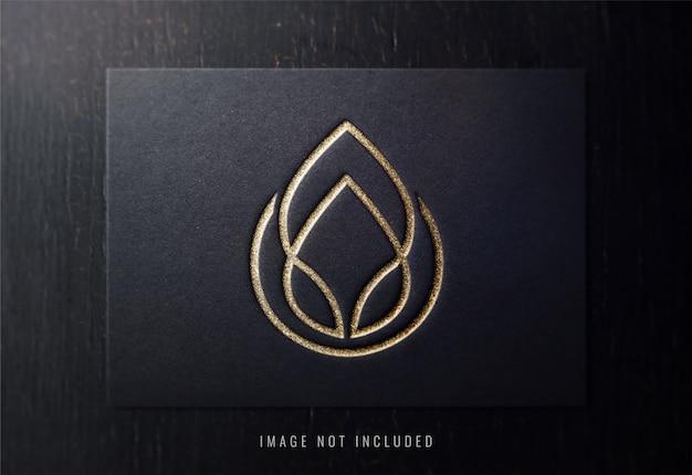 Luksusowa makieta logo na czarnym papierze