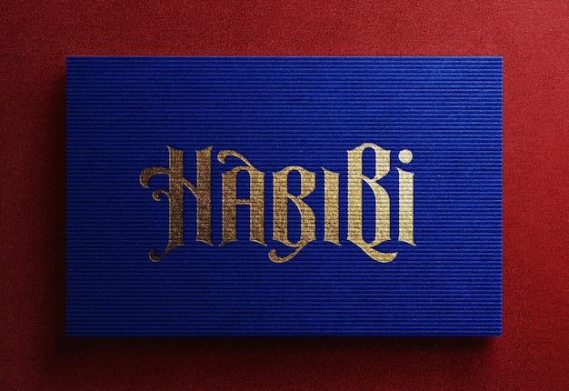 Luksusowy makieta logo na niebieskiej wizytówce