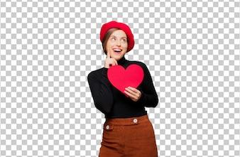 Młoda ładna kobieta wyraża miłości pojęcie dla valentines dnia