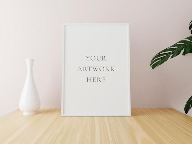 Makieta biała pionowa rama na drewnianym stole z wazonem i roślinami. renderowania 3d.