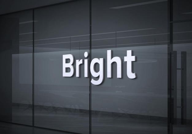 Makieta białego logo na szklanej ścianie firmy