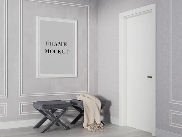 Makieta białej ramy ściennej obok białych drzwi