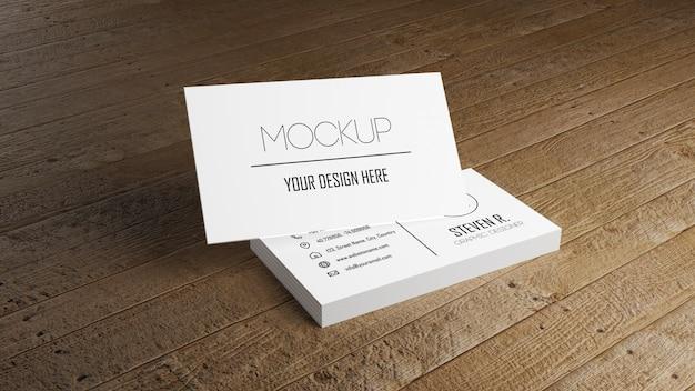 Makieta biały wizytówki układania na drewnianym stole.