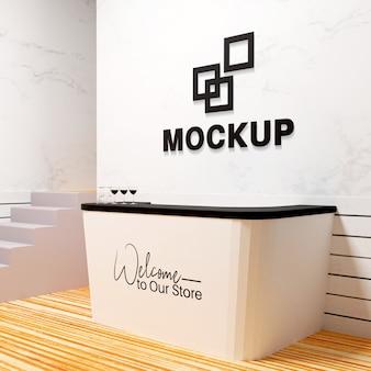Makieta biurka i logo na ścianie