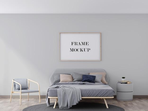Makieta drewnianej ramy ściennej nad szarym łóżkiem