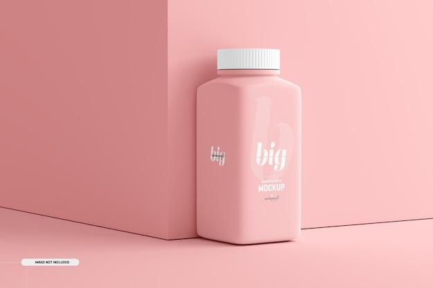 Makieta dużej kwadratowej butelki z suplementem pigułki