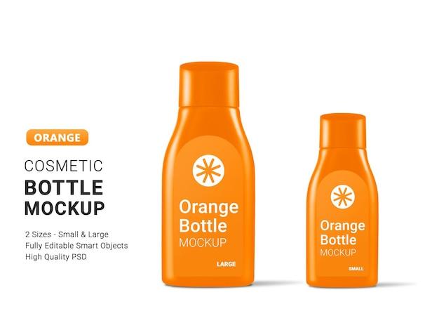 Makieta dużych i małych pomarańczowych butelek kosmetycznych