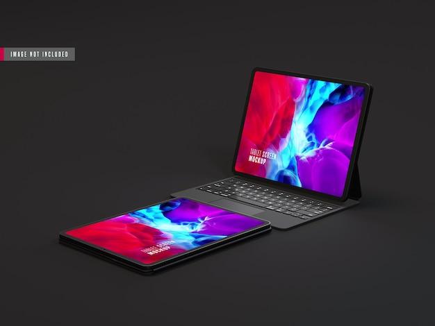 Makieta dwóch na białym tle ciemny tablet pro z klawiaturą