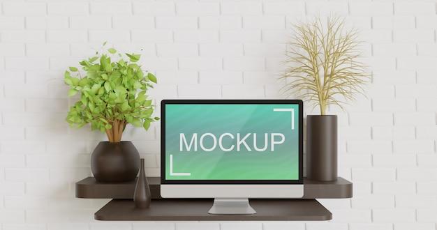 Makieta ekranu komputera na drewnianym stole ściennym