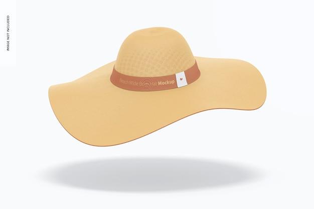 Makieta kapelusza z szerokim rondem na plaży, spadająca
