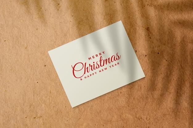 Makieta kartki świątecznej z cieniem liści palmowych