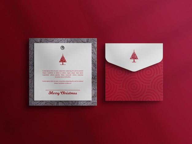 Makieta karty z zaproszeniem na boże narodzenie z makieta koperty
