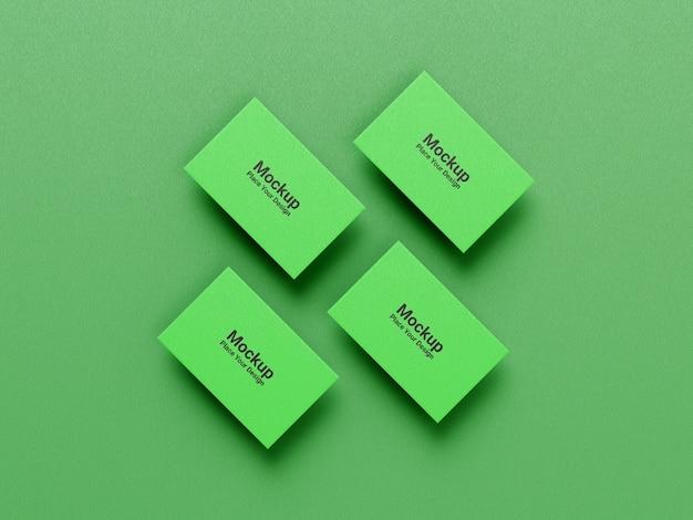 Makieta kolekcji wizytówek na zielonym tle